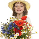 little girl with big bouquet of wild flowers