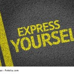 Express Yourself written on the road