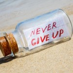 Message in bottle on beach. Creative hope and faith concept.