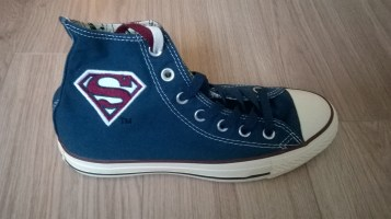 Superman Converse showing red and white logo on blue background