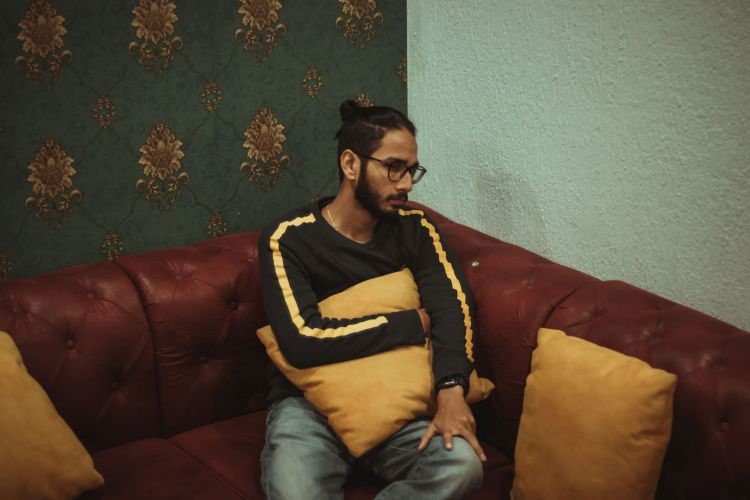 Photo by Dollar Gill on Unsplash man on a couch