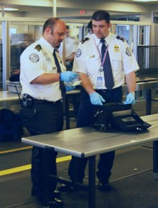 TSA agents in Boston. Image by DHS, public domain.