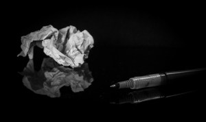 Pen and crumpled up piece of paper