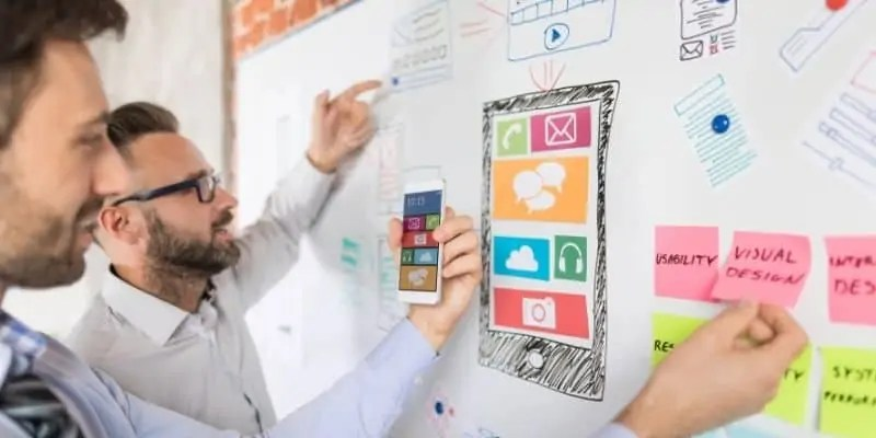 app developer two men with app diagram on white board