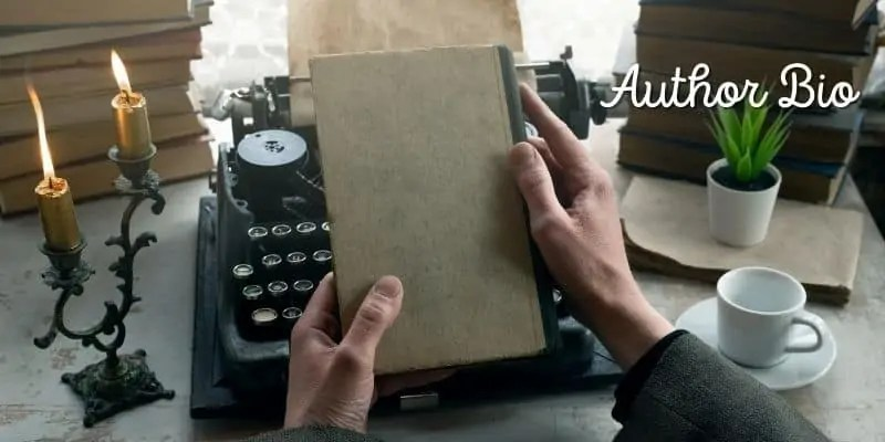 person with typewriter and book
