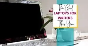 black and silver laptop with green and pink plan and white coffee cup