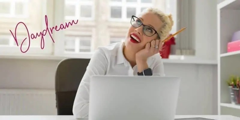 daydream blond-haired woman in glasses daydreaming