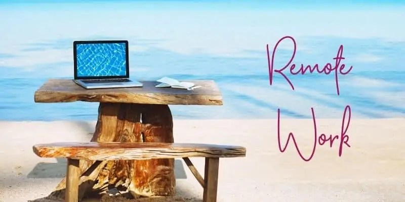 digital nomad podcasts laptop on wooden picnic table on ocean