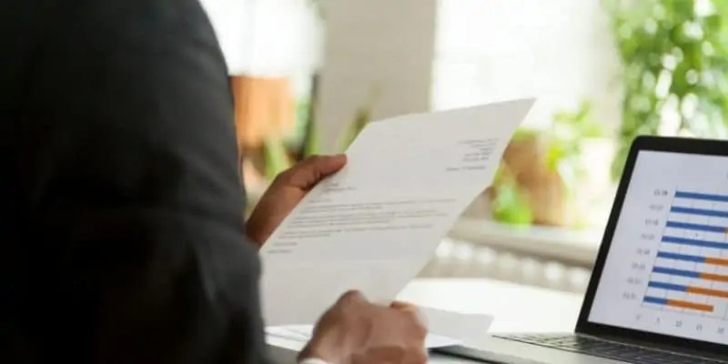 man looking at cover letter