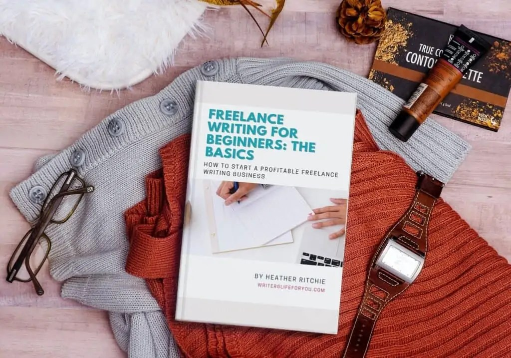 mock up of freelance writing for beginners book on sweaters with watch