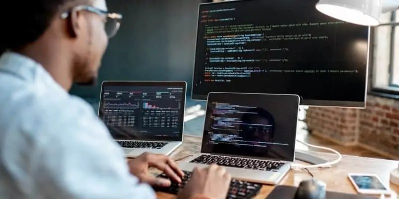business ideas for introverts person coding on multiple computers