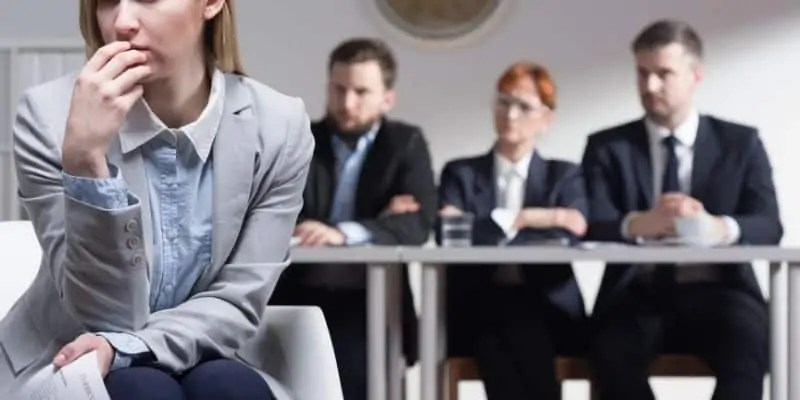 woman waiting on decision by interview panel