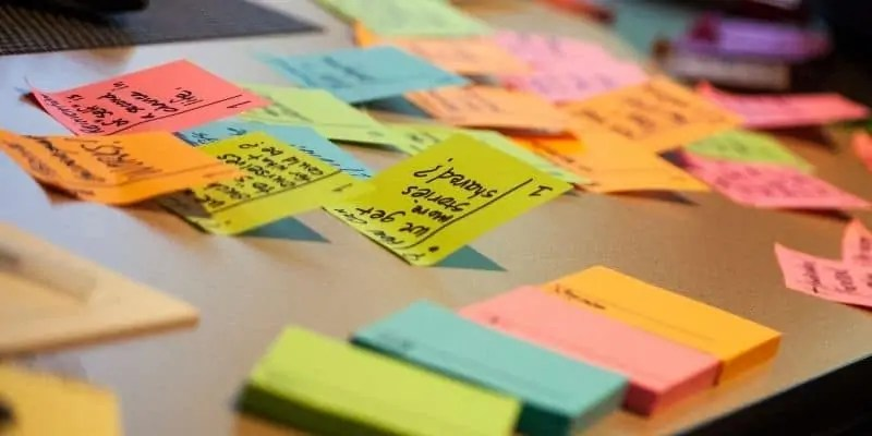freelance writing business plan sticky notes on table