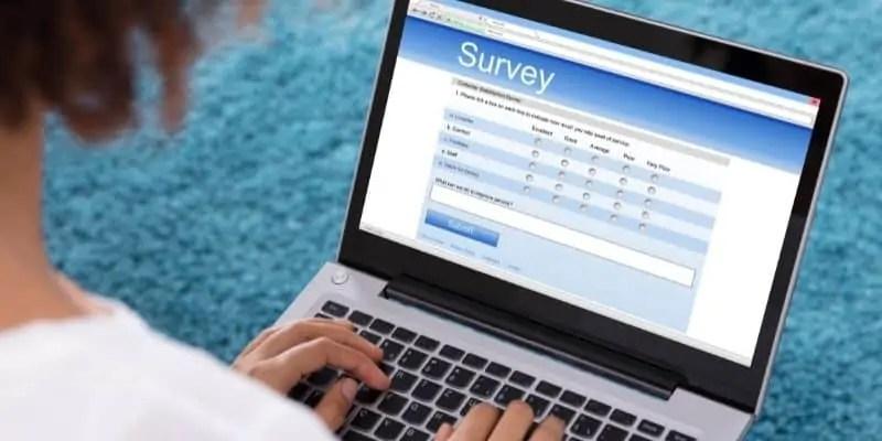 surveys extra money for Christmas woman taking survey on laptop