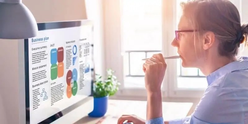 woman on a computer writing a business plan