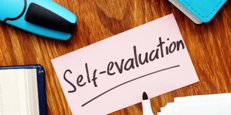 work from home successfully self-evaluation on sticky not and pen