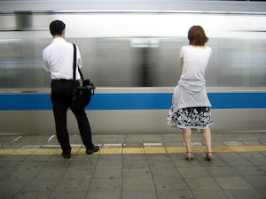 Man and woman standing on train platform