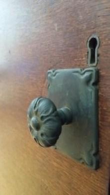 ooden door with doorknob and keyhole