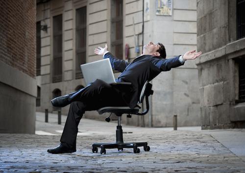 man in street on desk chair