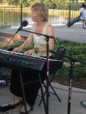 Trina Brunk singing and playing the piano.
