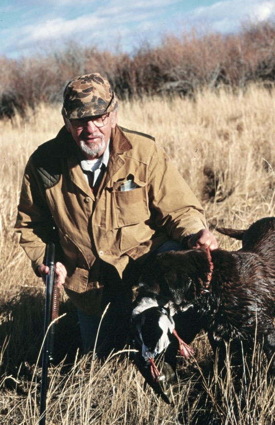 Two hunting partners: John Banovich, and my chocolate Lab, Alix (d-1998). We had wonderful times together.