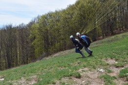 To take off, you just run straight down the hill till the wind picks you up.