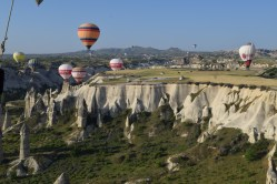 Balloons over Love Valley, with the fair chimneys below.