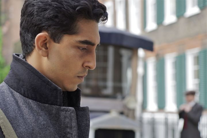 MAN Close up of an ill Ramanujan (Dev Patel) walking through the streets of London