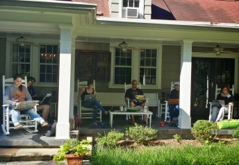 A group of students working on the porch of the reteat house