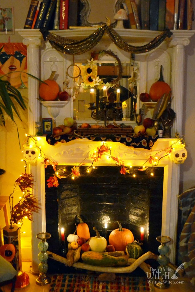 fireplace decorated with pumpkins and candles