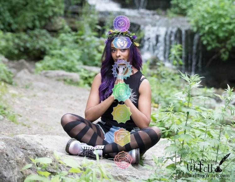 woman meditating with chakra symbols
