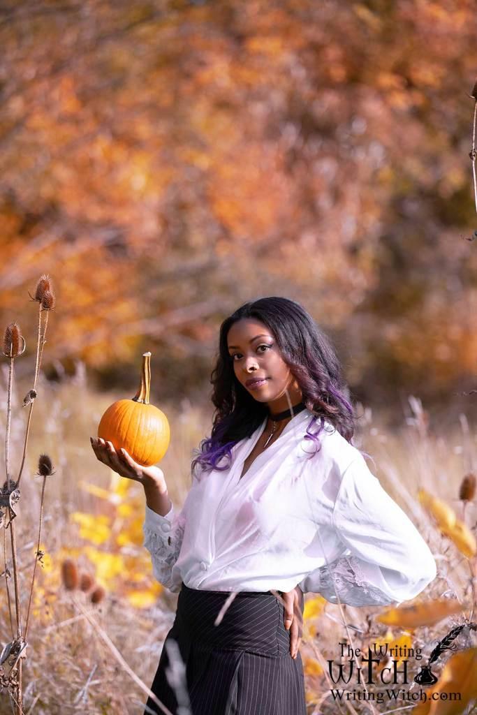 woman-in-autumn field with pumpkin