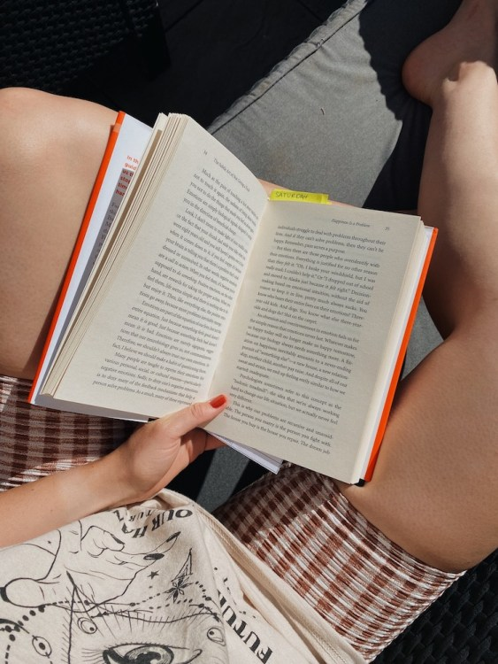 six month reset - wellbeing image of reading a book