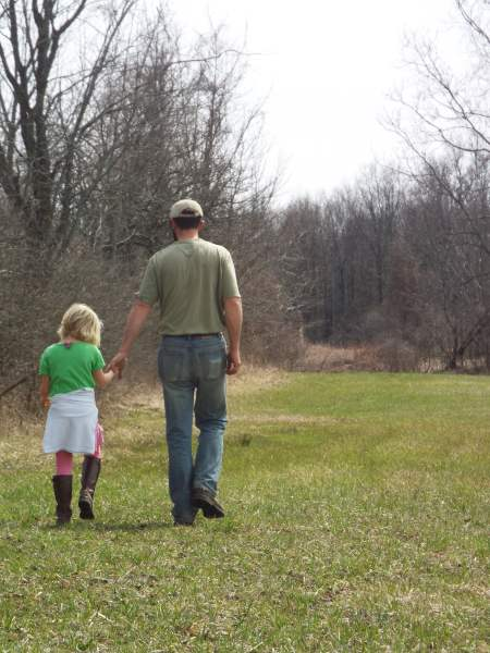 dad and daughter checking out the pastures