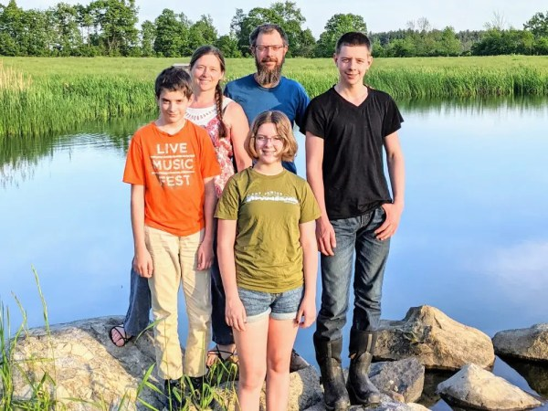 The Perozzi family at Wrong Direction Farm.  WDF specializes in grass fed beef and certified organic pasture raised chickens.