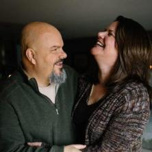Photo of Stephanie and her late husband Jeff laughing together.