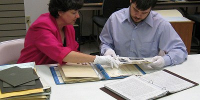 Staff reviewing historic records