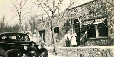 Doctor Threadgill and Jeanett Davis standing in front of the doctor's office