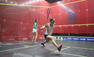 King marches past Sherbini
