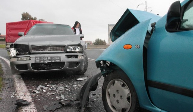 blue-and-gray-car-after-an-accident-on-a-road