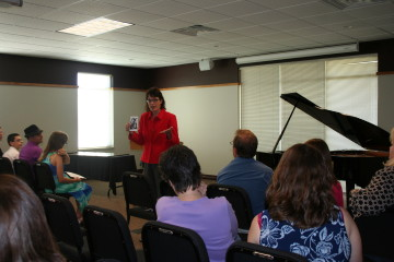 Julie Palkowski, Fine Arts and Creativity Education Consultant for the State of Wisconsin Department of Public Instruction, speaks to students on creativity and composing...