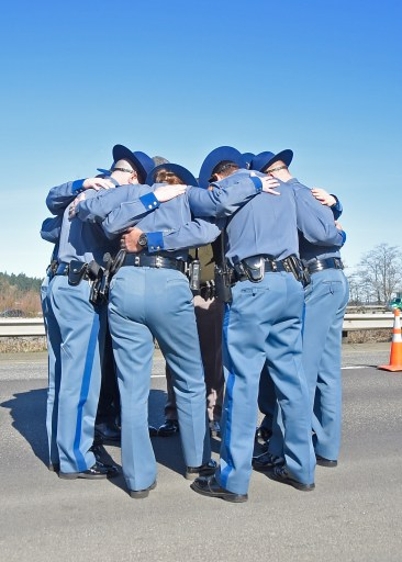 Troopers huddle together to remember Trooper Tony