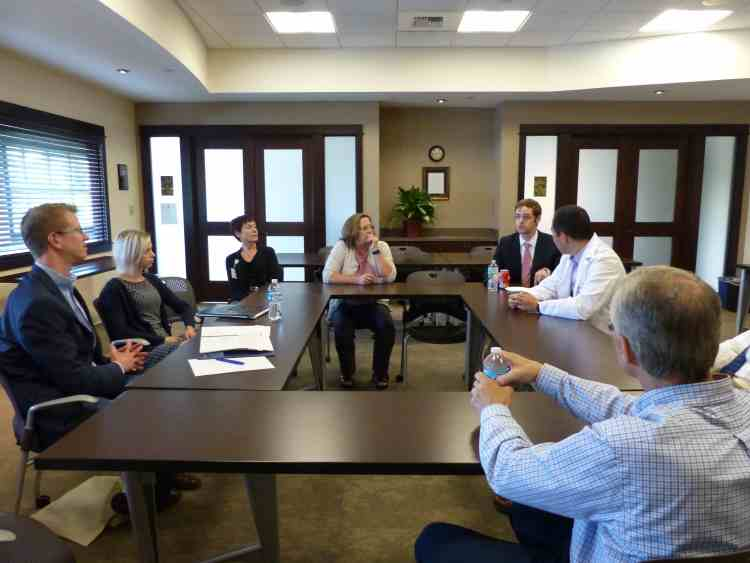 Rep Kilmer - far left - listens to concerns of radiologists during visit to CMBC