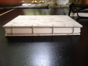 Coptic binding, carefully sewn