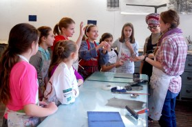 Artist-in-residence Laura Manfredi and intern Mary Gordon introduce students to intaglio printmaking