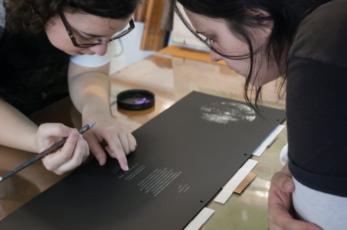 Natalia Zapella works with studio intern Ellen Prosko