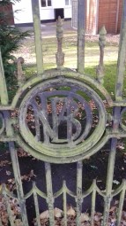Maneckjee B Dadabhoy's initials on the gate