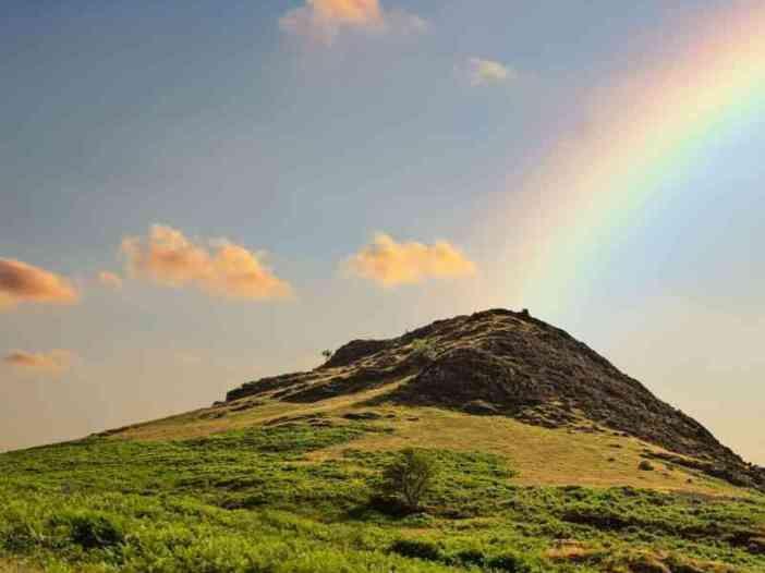 Rainbow over the mountain nature image