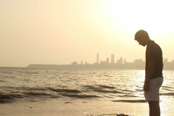 Lonely boy standing on the beach image for whatsapp dp