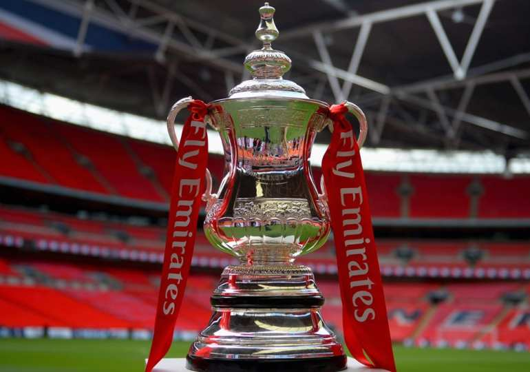 emirates fa cup on stand on pitch - WTX News Breaking News, fashion & Culture from around the World - Daily News Briefings -Finance, Business, Politics & Sports